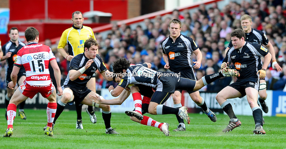 02.04.2011 Aviva Premiership Rugby from the Kingsholm Ground. Gloucester v Newcastle Falcons. Gloucester Winger (#14) Jonny May is tackled by Newcastle Falcons Winger (#11) Rikki Sheriffe in the first half