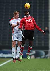 Bristol City's Mark Little battles for the high ball with Milton Keynes Dons' Dean Lewington  - Photo mandatory by-line: Joe Meredith/JMP - Mobile: 07966 386802 - 07/02/2015 - SPORT - Football - Milton Keynes - Stadium MK - MK Dons v Bristol City - Sky Bet League One