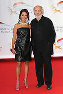 MONACO - JUNE 06:  Saida Jawad and Gerard Jugnot arrive at the 51st Monte Carlo TV Festival Opening Ceremony on June 6, 2011 in Monaco, Monaco.  (Photo by Tony Barson/WireImage)