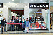 Mezlan employees, shoppers, and members of the San Jose Silicon Valley Chamber of Commerce enjoy refreshments and a raffle drawing during the Mezlan San Jose Ribbon Cutting ceremony at Westfield Valley Fair Mall in Santa Clara, California, on December 19, 2013. (Stan Olszewski/SOSKIphoto)