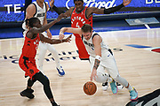 Dallas Mavericks point guard Luka Doncic (77) heavily guarded by Toronto Raptors forward Chris Boucher (25) and Rondae Hollis-Jefferson (4) during an NBA basketball game, Saturday, Nov. 16, 2019, in Dallas. The Mavericks defeated the Raptors 110-102. (Wayne Gooden/Image of Sport)