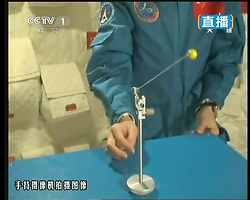 59870555  <br /> This TV grab taken on June 20, 2013 shows female astronaut Wang Yaping, one of the three crew members of Shenzhou-10 spacecraft, demonstrating pendulum movement in space during a lecture to students on Earth aboard China s space module Tiangong-1. A special lecture began Thursday morning, given by Wang Yaping aboard China s space module Tiangong-1 to students on Earth, Thursday June 20, 2013.<br /> UK ONLY
