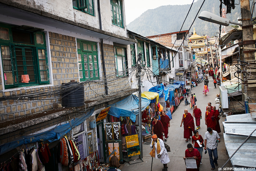 An overhead view of Tibetan monks walking the street in the city center of McLeodGanj, Dharamsala, India.