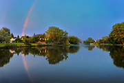Rainbow reflected in pond in Southdale Neighbourhood<br />
