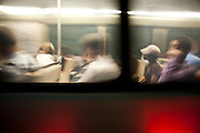 Commuters and travelers are pictured in a blur as a Metro subway car passes by in Washington, D.C on July 1, 2008.