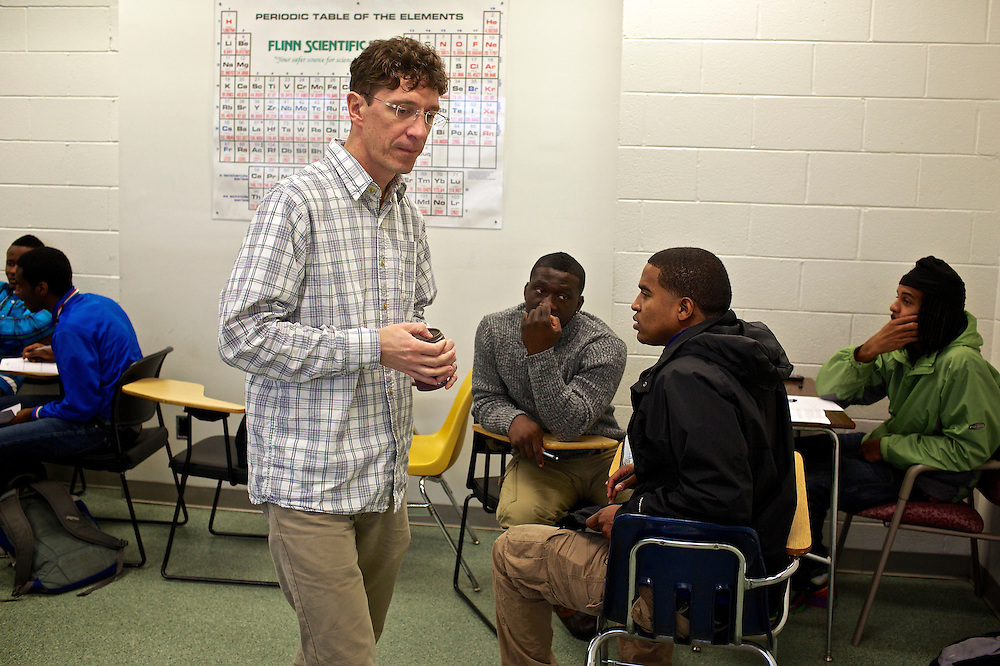 Greg Wahl, center, associate professor at Montgomery College, works with students in his Basic Writing II class, as they started working on their final project. If students pass this class, it allows them to progress to the college level english program. Otherwise students will face the decision to take the remedial class again or drop out.