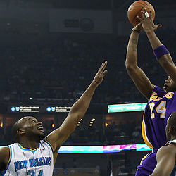 April 28, 2011; New Orleans, LA, USA; Los Angeles Lakers shooting guard Kobe Bryant (24) shoots over New Orleans Hornets point guard Chris Paul (3) and power forward Carl Landry (24) during the first quarter in game six of the first round of the 2011 NBA playoffs at the New Orleans Arena.    Mandatory Credit: Derick E. Hingle
