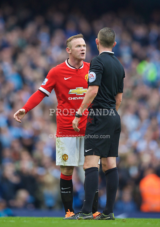 MANCHESTER, ENGLAND - Sunday, November 2, 2014: Manchester United's Wayne Rooney is spoken to by referee Michael Oliver during the Premier League match against Manchester City at the City of Manchester Stadium. (Pic by David Rawcliffe/Propaganda)
