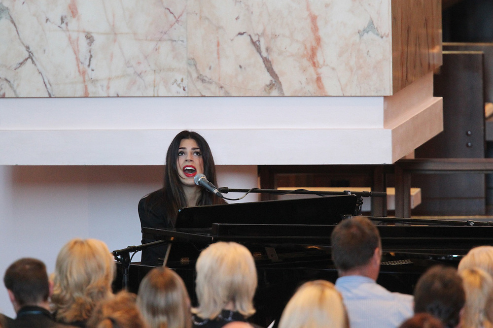 Brooke Fraser, daughter of Bernie Fraser, a long time friend of the late respected lawyer Greg King sings at his funeral, in St Pauls Cathedral, Wellington, New Zealand, Friday, November 09, 2012. Credit:SNPA / DominionPost, Phil Reid  **POOL**