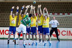 Zarko Markovic of Goeppingen vs players of Koper during handball match between RK Cimos Koper and Frisch Auf Goeppingen (GER) in 3rd Round of EHF Cup 2012/2013, on February 23, 2013 in Arena Bonifika, Koper, Slovenia. (Photo By Vid Ponikvar / Sportida)
