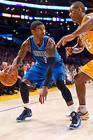 30 October 2012: Guard (32) O.J. Mayo of the Dallas Mavericks dribbles while being defended by (15) Meta World Peace of the Los Angeles Lakers during the first half of the Mavericks 99-91 victory over the Lakers at the STAPLES Center in Los Angeles, CA.