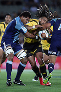 Hurricanes' Ma'a Nonu is tackled by Blues' Peter Saili. Super 15 rugby union match, Blues v Hurricanes at Eden Park, Auckland, New Zealand. Saturday 19th March 2011. Photo: Anthony Au-Yeung / photosport.co.nz