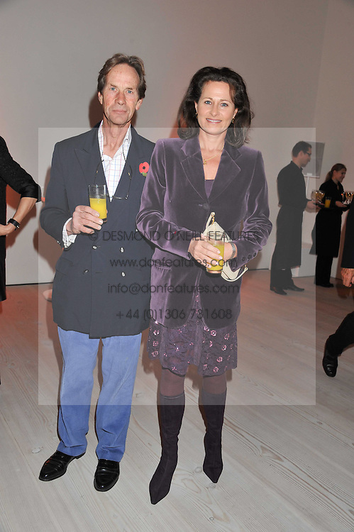 """HENRIETTA, COUNTESS OF CALEDON and JIMMY COULDREY at the launch of """"Photo-Me by Starck"""" – a photobooth exclusively designed by the world renowned artist and creator Philippe Starck held at The Saatchi Gallery, Duke Of York Square, Kings Road, London on 2nd November 2011."""