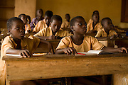 "Aisha Alhassan, 12 (second from left) attends class at the Nyologu Primary School in the village of Nyologu, northern Ghana, on Wednesday June 6, 2007. ""I like to study maths,"" says Aisha, who helps her parents at home by picking shea nuts, fetching water and washing bowls. ""I want to become a nurse, so I can take care of mother if she becomes sick,"" she adds. Only 4 of 21 students in this class are girls.."