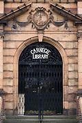 The frontage of Carnegie Library in Herne Hill. Faced with the closure of its local library, Lambeth council plan to close the facility used by the community as part of austerity cuts, saying they will convert the building into a gym and privatey-owned gentrified businesses - rather than a much-loved reading and learning resource. £12,600 was donated by the American philanthropist Andrew Carnegie to help build the library which opened in 1906. It is a fine example of Edwardian civic architecture, built with red Flettan bricks and terracotta, listed as Grade II in 1981.