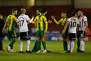 Players shake hands at full time during the EFL Sky Bet Championship match between Sheffield United and West Bromwich Albion at Bramall Lane, Sheffield, England on 14 December 2018.
