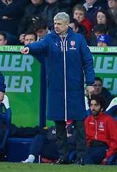 LONDON, ENGLAND - Saturday, February 21, 2015: Arsenal's manager Arsene Wenger against Crystal Palace during the Premier League match at Selhurst Park. (Pic by David Rawcliffe/Propaganda)