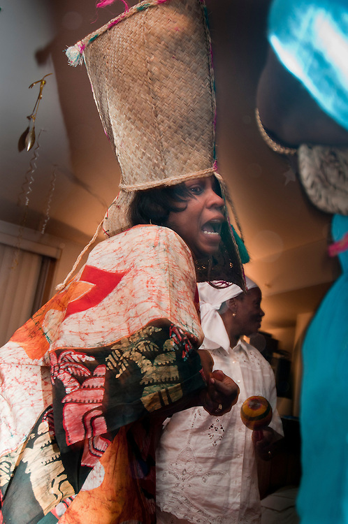 Vodou ceremony during the winter solstice in a suburbs of Montreal. the participant is possessed by Kouzin Zaka, the spirit of agriculture and commerce