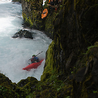 A kayaker struggles with the hydraulics bellow Chaos Falls during the Slalom event of the Little White Salmon Race.