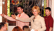 "Tamra Francis as Gail Augury (center) teaches audience members how TV weather reporters use a 'green screen' during Mayhem & Mystery's production of ""Newsworthy Nemesis"" at the Spaghetti Warehouse in downtown Dayton, Friday, March 9, 2012."
