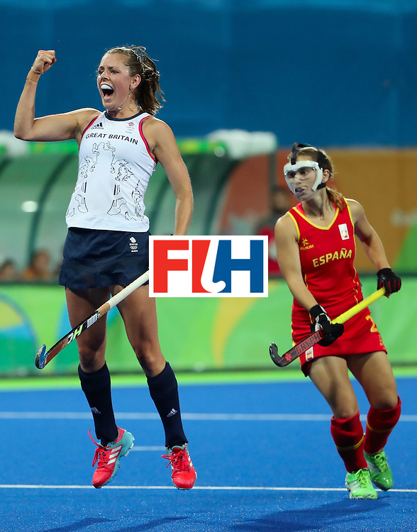 RIO DE JANEIRO, BRAZIL - AUGUST 15:  Giselle Ansley #18 of Great Britain celebrates ahead of Alicia Magaz #25 of Spain after Georgie Twigg (not pictured) scored a first half goal during the quarter final hockey game on Day 10 of the Rio 2016 Olympic Games at the Olympic Hockey Centre on August 15, 2016 in Rio de Janeiro, Brazil.  (Photo by Christian Petersen/Getty Images)