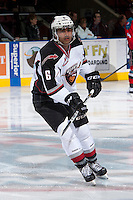 KELOWNA, CANADA - MARCH 15: Arvin Atwal #6 of the Vancouver Giants warms up against the Kelowna Rockets on March 15, 2014 at Prospera Place in Kelowna, British Columbia, Canada.   (Photo by Marissa Baecker/Getty Images)  *** Local Caption *** Arvin Atwal;