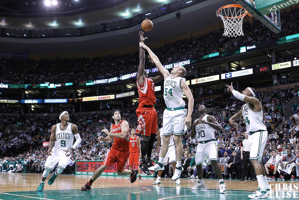 06 March 2012: Houston Rockets center Samuel Dalembert (21) goes for the skyhook over Boston Celtics center Greg Stiemsma (54) during the Boston Celtics 97-92 (OT) victory over the Houston Rockets at the TD Garden, Boston, Massachusetts, USA.