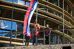 Petra Majdic raising Slovenian flag at official opening of the new Nordic centre Planica, on December 11, 2015 in Planica, Slovenia. Photo by Vid Ponikvar / Sportida