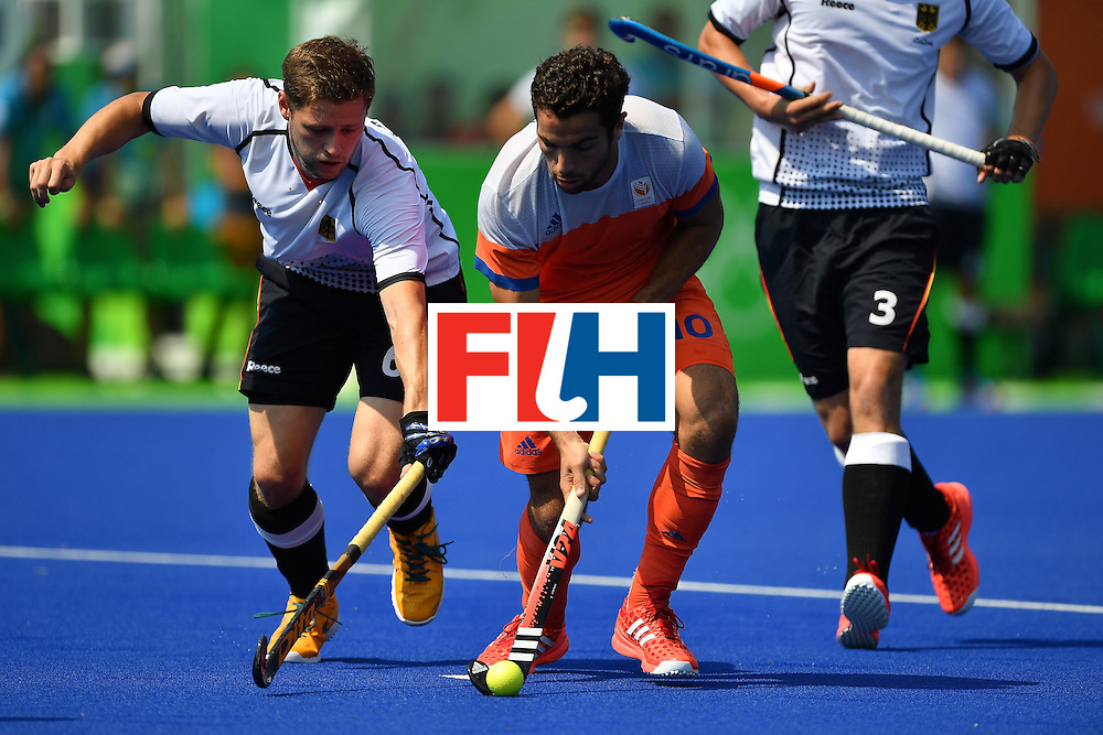 RIO DE JANEIRO, BRAZIL - AUGUST 18:  Player Martin Haner of Germany contests the ball with Valentin Verga of the Netherlands during the Hockey Bronze medal match in the Olympic Hockey centre on Day 13 of the Olympic games on August 18, 2016 in Rio de Janeiro, Brazil.  (Photo by Pascal Le Segretain/Getty Images)