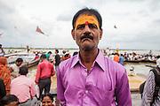 Hindu man portrayed at Dashashwamedh Gath by the Ganges River in Varanasi, India.