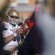 Salesianum quarterback Garrett Cannon (6) warms up on the sidelines during a regular season football game between No. 2 Salesianum and No.1 William Penn Saturday, Oct. 31, 2015 at William Penn High School in New Castle.