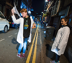 """© Licensed to London News Pictures . Manchester , UK . 05/04/2015 . Bar workers in Manchester's """" Gay Village """" . Revellers on a Saturday night out during the Easter Bank Holiday weekend . Photo credit : Joel Goodman/LNP"""