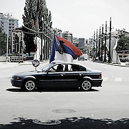 Serbs celebrate marriage near the bridge connecting the two halves of the divided city of Kosovska Mitrovica
