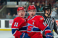 KELOWNA, CANADA - MARCH 13:  Jaret Anderson-Dolan #11 and Ethan McIndoe #10 of the Spokane Chiefs celebrate the overtime winning goal against the Kelowna Rockets on March 13, 2019 at Prospera Place in Kelowna, British Columbia, Canada.  (Photo by Marissa Baecker/Shoot the Breeze)