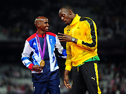 File photo dated 11-08-2012 of Great Britain Mo Farah with Usain Bolt with a gold medal after victory in the Men's 5000m final on day fifteen of the London Olympic Games in the Olympic Stadium, London.