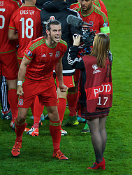 CARDIFF, WALES - Tuesday, October 13, 2015: Wales' Gareth Bale celebrates on the pitch after qualifying for the finals following a 2-0 victory over Andorra during the UEFA Euro 2016 qualifying Group B match at the Cardiff City Stadium. Holly Williams. (Pic by Paul Currie/Propaganda)