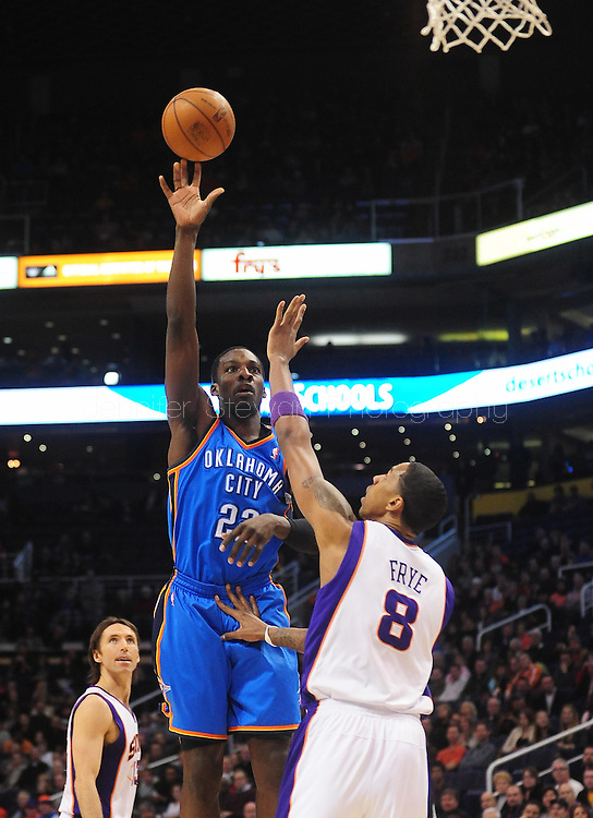 Feb. 4, 2011; Phoenix, AZ, USA; Oklahoma City Thunder forward Jeff Green (22) puts up a shot against the Phoenix Suns forward Channing Frye (8) at the US Airways Center. Mandatory Credit: Jennifer Stewart-US PRESSWIRE