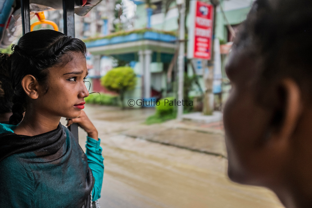 Mayesha, 14, on a rickshaw, on her way to surf on the beach of Cox's Bazar, Bangladesh