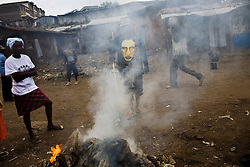 Trash burns in Mathare, one of the poorest slums in Nairobi.  Running water and electricity are scarce and trash and human waste fills the streets.  Many people have no jobs and those who do work can earn less than one dollar a day.