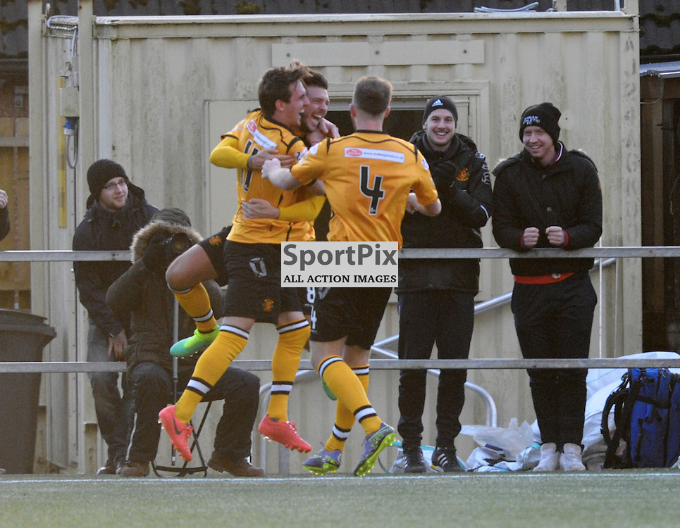 Matty Flynn  (Annan Athletic, amber &amp; black, 8) scores his second to make it 3-0<br /> <br /> Annan Athletic v Elgin City, SPFL League 2, 30th January 2016<br /> <br /> (c) Alex Todd | SportPix.org.uk
