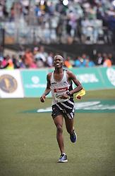 10062018 (Durban) A 6th position Gordon Lesetedi, RSA (5:39:32) run towards the finnish line during the 2018 Comrades marathon in Durban.<br /> Picture: Motshwari Mofokeng/ANA