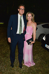 MAX KONIG & JULIET FETHERSTONHAUGH attending Annabel Goldsmith's Summer party held at her home in Ham, Surrey on 10th July 2014.