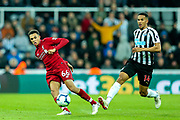 Trent Alexander-Arnold (#66) of Liverpool passes the ball around the challenge pf Isaac Hayden (#14) of Newcastle United during the Premier League match between Newcastle United and Liverpool at St. James's Park, Newcastle, England on 4 May 2019.