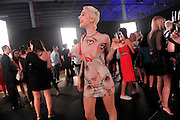 Tea Hacic, wearing her own design, waits for the start of the Gareth Pugh fashion presentation, part of the Lexus Design Disrupted program, during New York Fashion Week, Thursday, Sept. 4, 2014.  (AP Photo/Diane Bondareff)