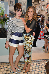 Left to right, GIZZI ERSKINE and AMANDA BYRAM at the Grand opening of Library - a new members club at 112 St Martin's Lane, London on 25th June 2014.