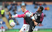 Jóhann Guðmundsson of Burnley(left) and Reece Brown of Peterborough United fight for the ball during the The FA Cup match between Burnley and Peterborough United at Turf Moor, Burnley, England on 4 January 2020.