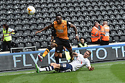 Calum Woods  sliding tackle on Ahmed Elmohamady  during the Sky Bet Championship match between Hull City and Preston North End at the KC Stadium, Kingston upon Hull, England on 29 August 2015. Photo by Ian Lyall.