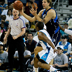 12 April 2009:Dallas Mavericks forward Dirk Nowitzki (41) passes away from New Orleans Hornets guard Chris Paul (3) during NBA game between the New Orleans Hornets and the Dallas Mavericks on Easter Sunday at the New Orleans Arena in New Orleans, Louisiana.