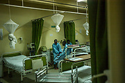 Innocent Nsabimana, 16, Chance Mwunguzi, 16, Alexis Nshimiyimana, 23, talk with each other prior to their surgeries at King Faisal Hospital. The young men became friends as they waited together for their surgeries.<br /> <br /> Rheumatic heart disease is damage to one or more heart valves that stems from inadequately treated strep throat. Left untreated, rheumatic heart disease leads to heart failure.