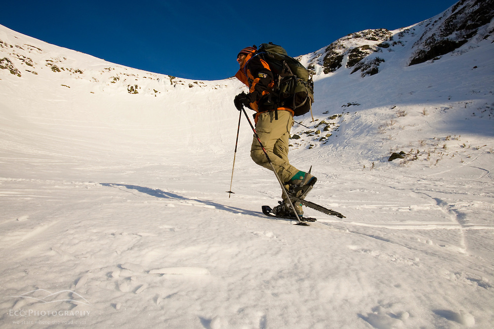 A man snowshoes in Tuckerman Ravine in New Hampshire's White Mountains. (MR)